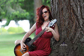 monica red dress guitar cool smile.jpg