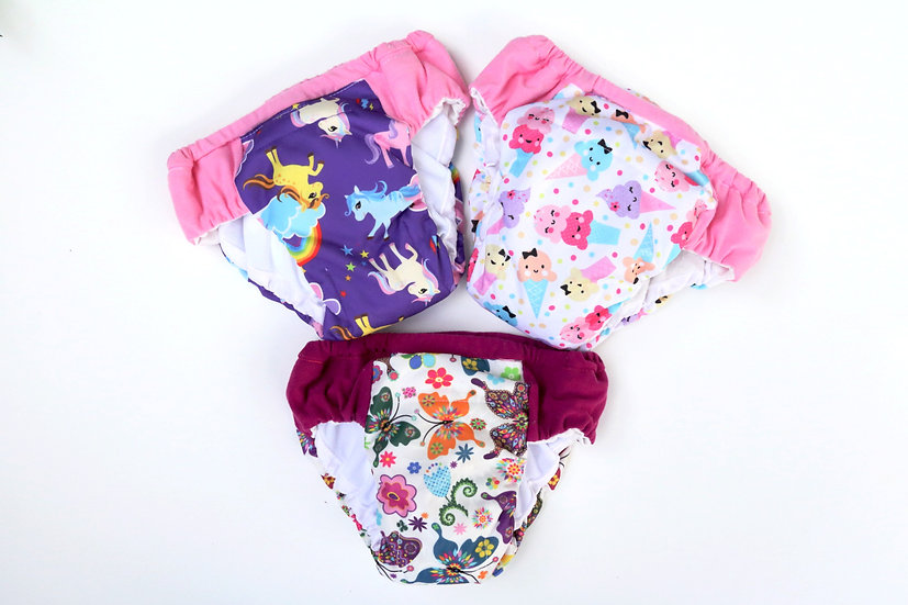 nighttime reusable diapers with waterproof PUL of ice cream, butterflies and purple ponies and rainbow front view