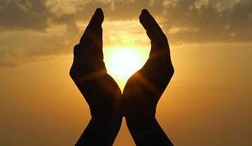hands toward sun.jpg