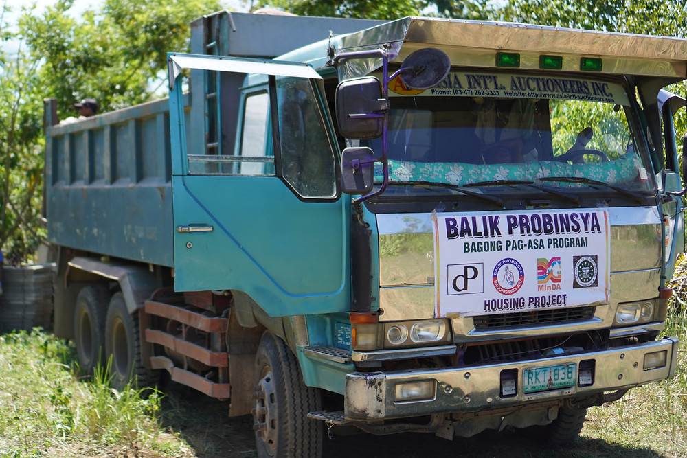A BPBPP truck hauled construction materials while site preparation for the model house is being done in a 6.3-hectare relocation site in Barangay Tacub, Kauswagan, Lanao del Norte. (Photo: HRS Media)