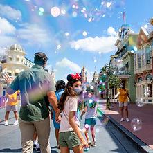 family having fun at a Disney theme park