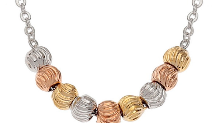small various metal colour beads threaded on chain necklace