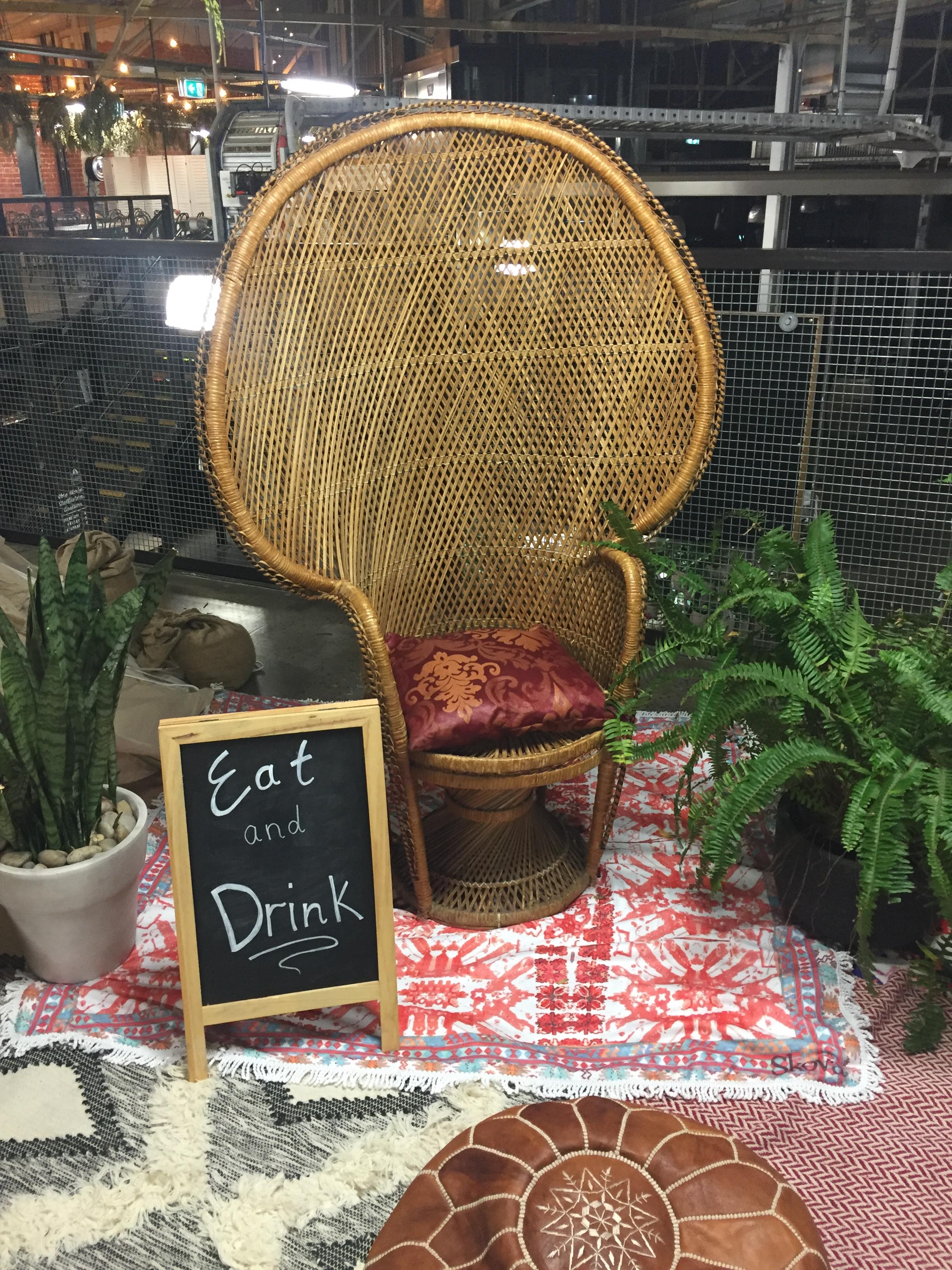 Peacock chair and chalkboard