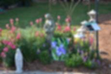 Garden Art with flowers in flowerbed