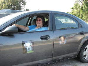 Car magents on display with a happy owner