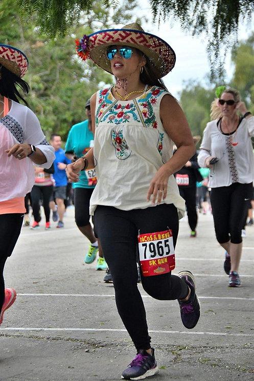running girl with sombrero.jpg