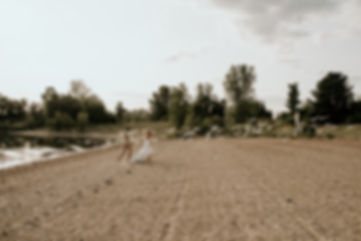Bride groom chasing running seagulls birds elopement wedding Ontario Canada