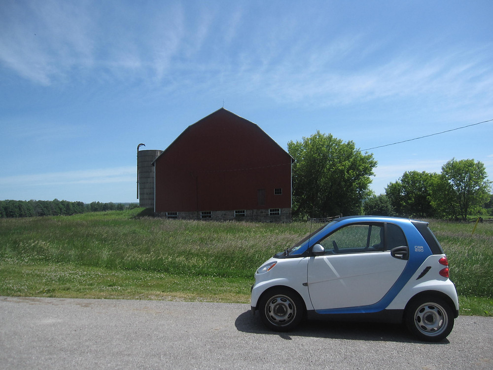 The car2go I rented to drive out to the Lands, in front of one of the barns at Thistle Ha' farm, expressing the big city-country contrast.