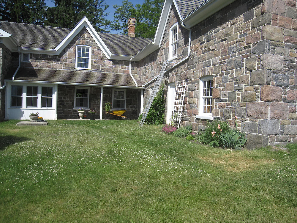 The Thistle Ha' farmhouse, built of granite stones from the ice age all collected from the 200 acre farm property.  The rubble has been squared on 5 sides, and there is white ribbon pointing between all the stones.  The original part of the house was built in 1855, with an addition made circa 1875.