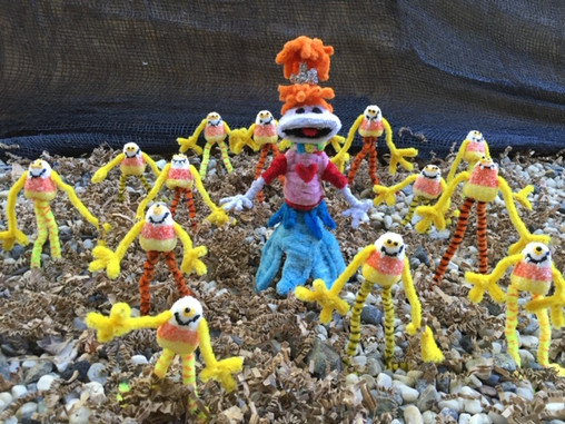 Lolly surrounded by candy corns.JPG