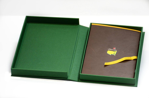 Clamshell box with ribbon and stitched booklet