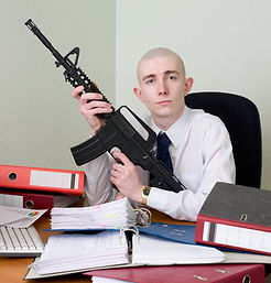 The chief accountant armed with a rifle.