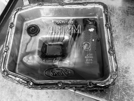 Contents of a transmission oil pan after being removed during a transmission service at Cedar Performance