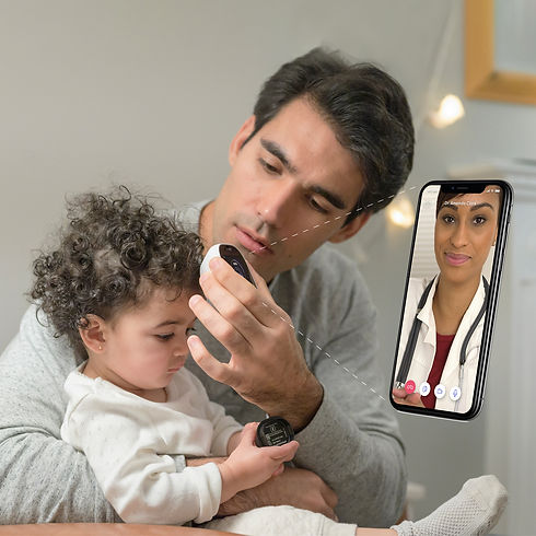 Dad and baby temp exam with doctor.jpg
