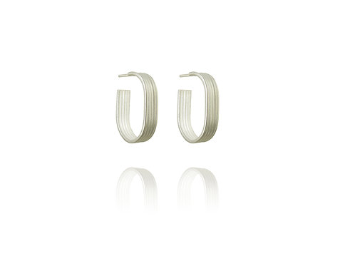 Linear silver oval hoops