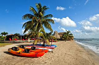 Canoes on the beach at Hopkins Bay in Belize.