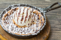 Baked cookie and ice cream dessert