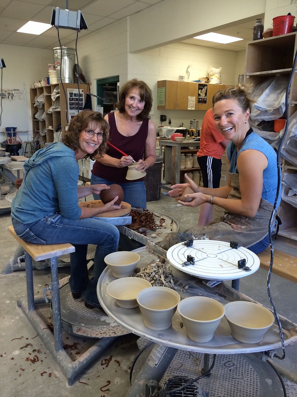 POWR Members Shawna Pickinpaugh, Dborah Britt and Cristin Zimmer throw bowls to donate to the upcoming Lander Care & Share Food Bank's Empty Bowls Fundraiser to be held in January, 2016