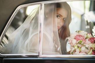 beautiful-bride-sits-with-wedding-bouquet-retro-car-has-fun.jpg