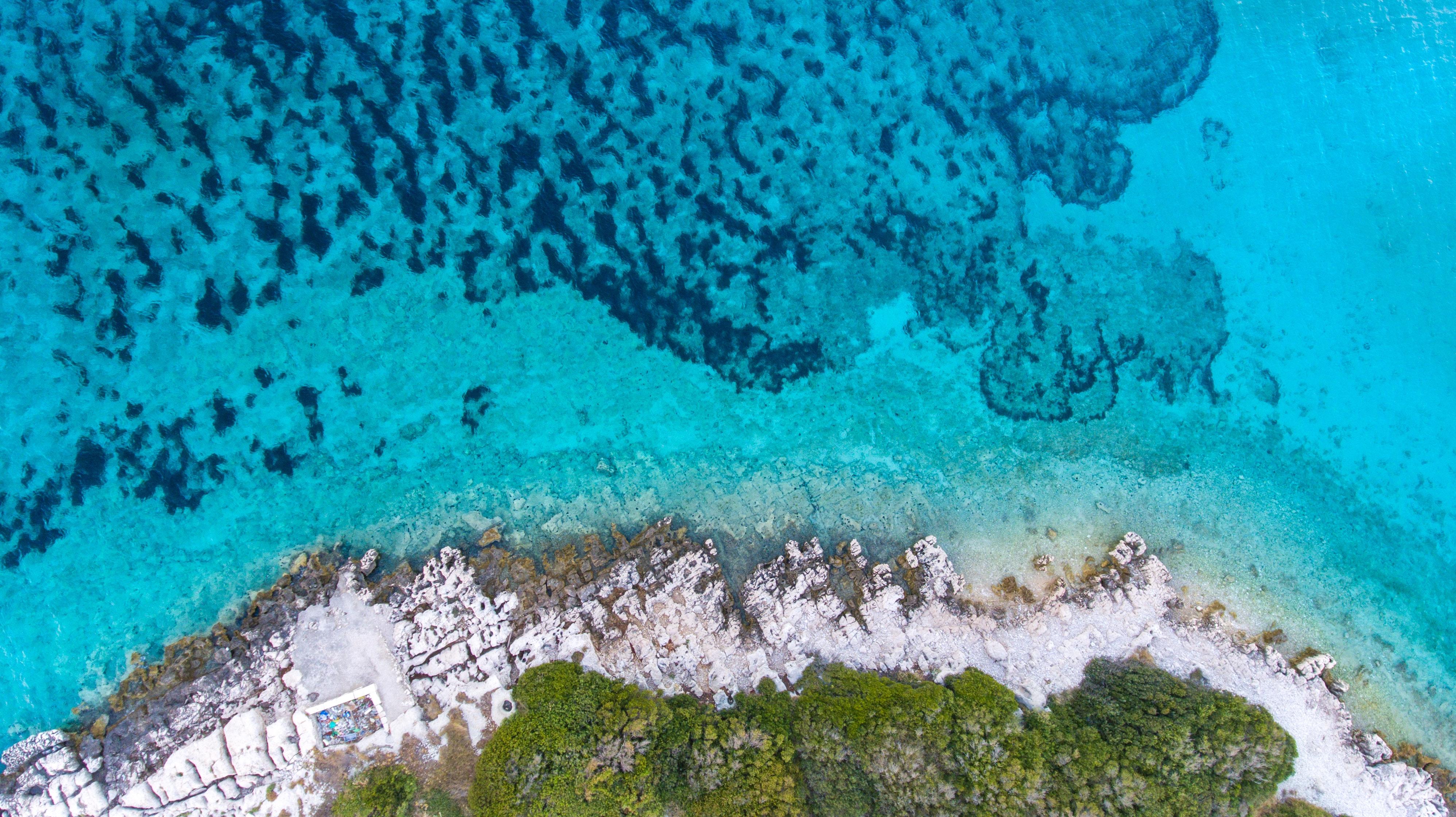 aerial-photography-of-island-1076887.jpg