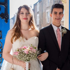 Bride, Elysha, walks down the aisle with her cousin, and a lovely dusky pink eye.