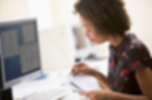 woman-in-computer-roon-circling-items-in
