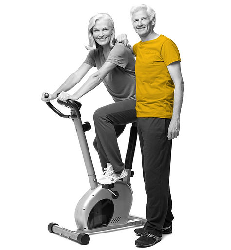 Mature couple on excercise bike