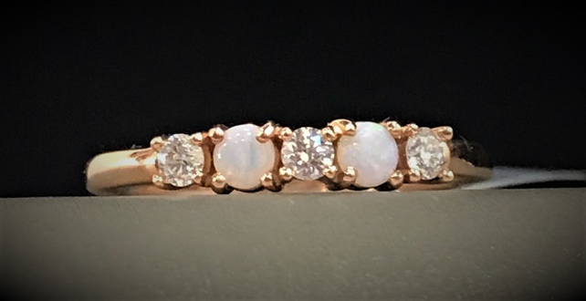 Rose Gold, Opal, and Diamond Ring