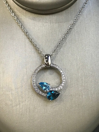 White Gold Blue Topaz and Diamond Necklace