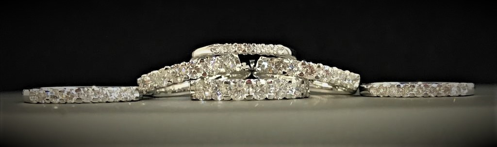 White Gold and Diamond Bands With 7 Stones
