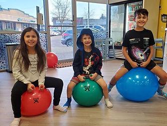 kids on balls.jpg