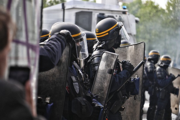 Authority personnel in armored uniform gear