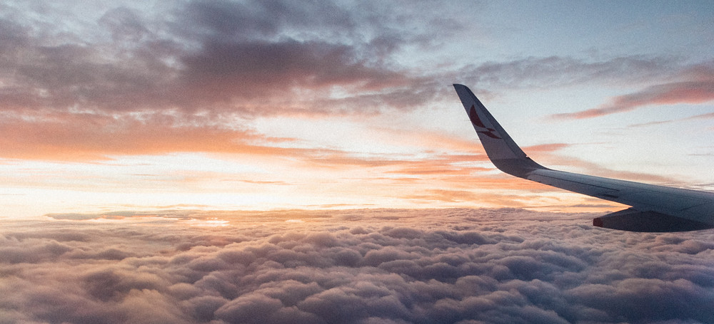 Airline wing above the clouds