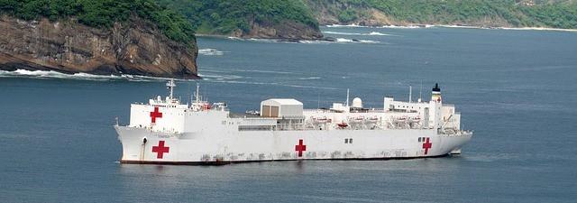 White hospital ship at sea of the coast.