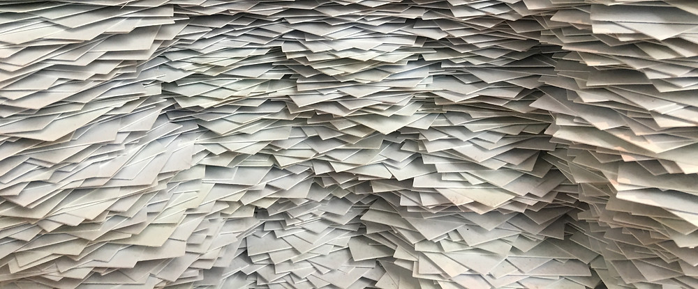 Stacked pile of white paper