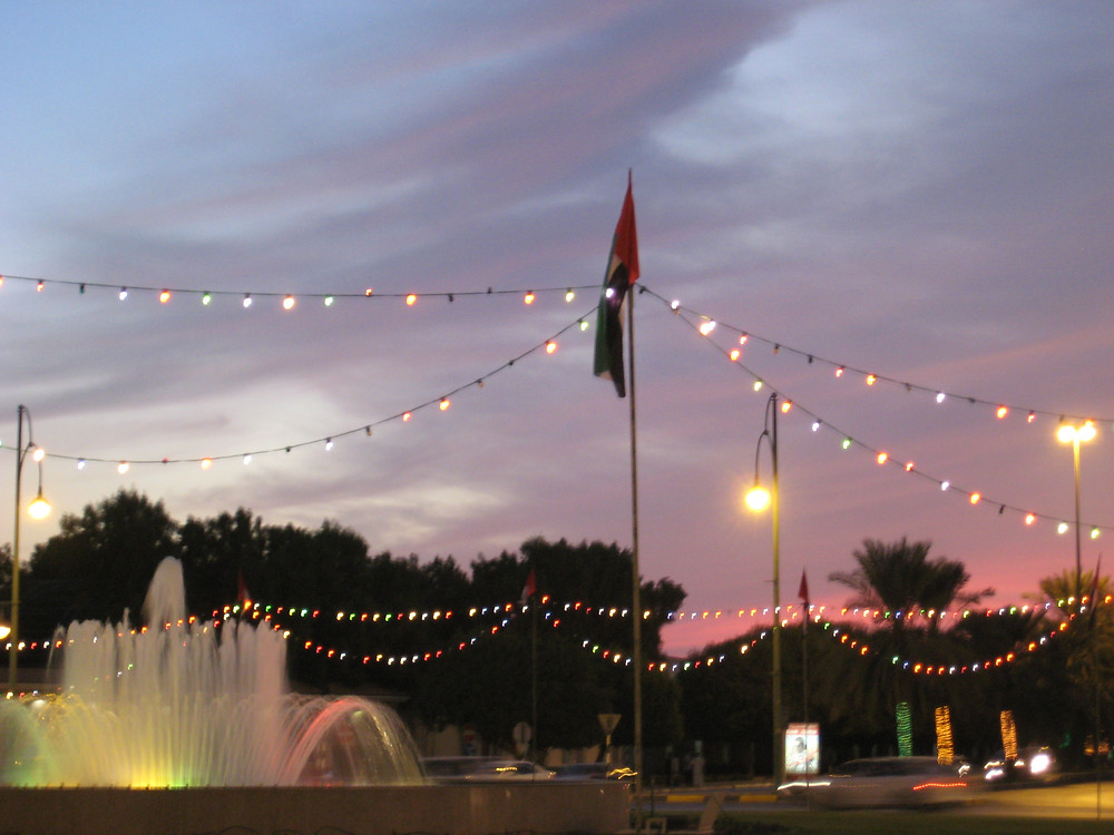 Water Fountain with with stringed light and the UAE flag.