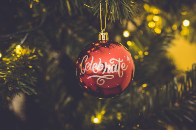 Red Holiday Ornament w/ Word Celebrate