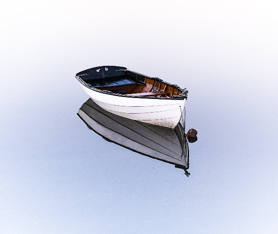 Empty boat with sitting on its reflection