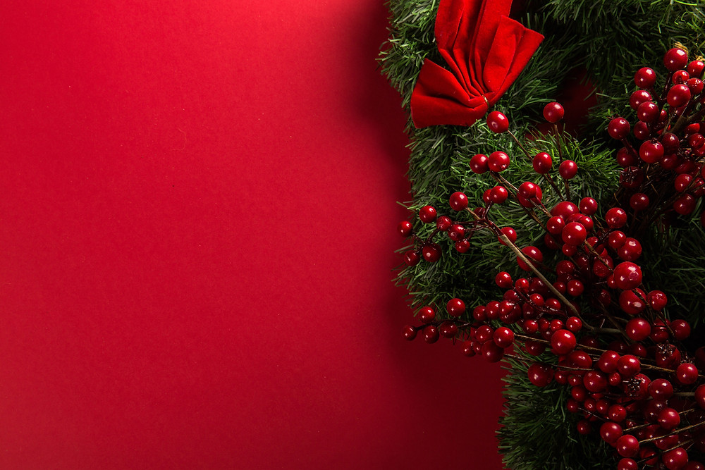 Photo by Tony Cuenca on Unsplash. Holly wreath. Sanctuary Christian Counseling in Shippensburg, PA