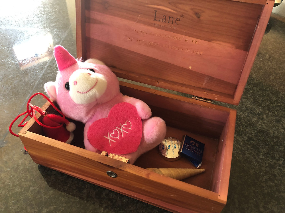 Small hope chest with chocolates, shell, stuffed animal, Christmas bell near Sanctuary Christian Counseling in Shippensburg, PA