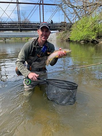 Joel Covert catching a fish in Pennsylvania; he specializes in kids, teens and individual therapy