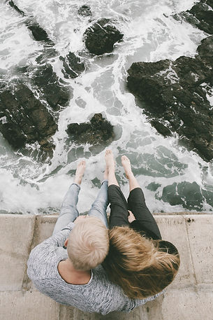 Couple sitting near running water in PA
