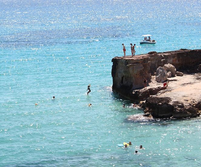 Cliff diving Cala Tarida