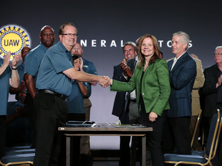 UAW members approve labor deal to end strike with GM; union selects Ford next