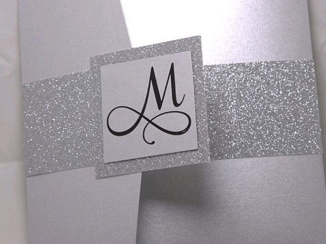 WEDDING INVITES _ Everybody loves a little #silver and #glitter. The #monogram is perfect. Our #pocketfolds are #amazing.jpg