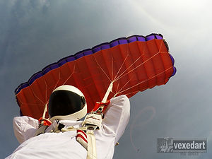 skydiver flying a parachute after filming