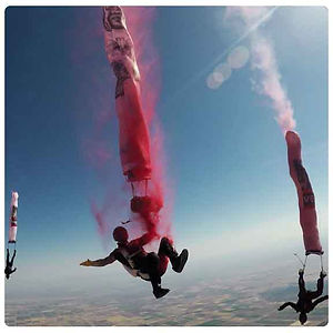 Skydive artist paints in freefall | painting the sky