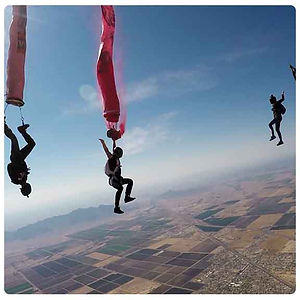 Painting and skydiving , skydivers Steve Curtis, Sara Curtis, Vedi Djokich, photo Johnny Gunn