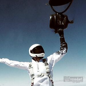 painted skydiver broken paint jug ruins white skydive jump suit | photo Sara Curtis