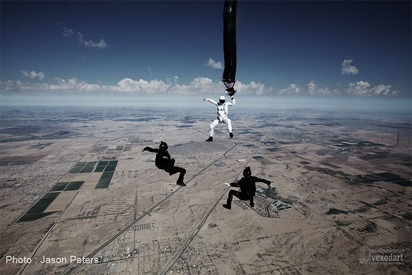 Jason Peters skydive photo of artist painting in freefall